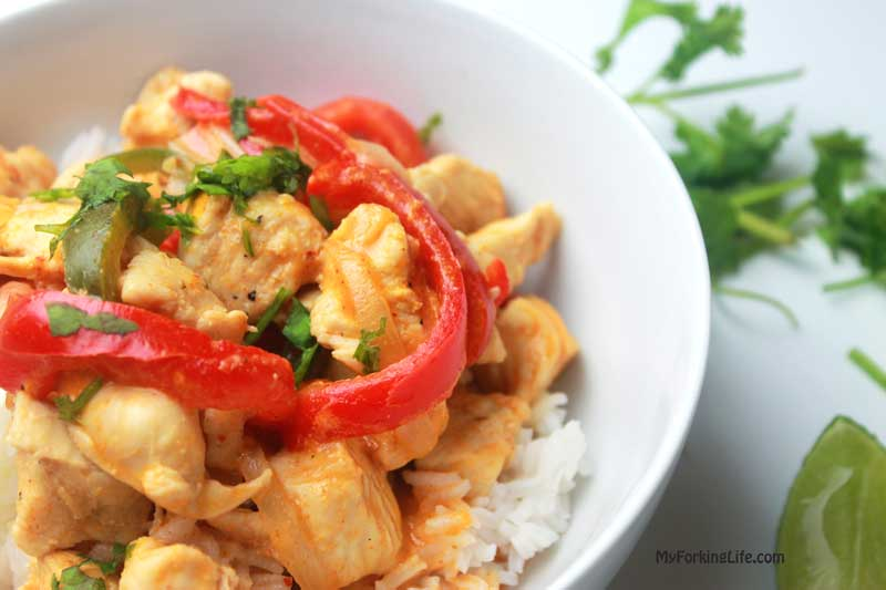 red curry chicken in a white bowl